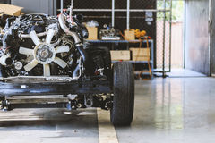 Closeup car chassis with engine. Soft-focus and over light in the background Stock Photography