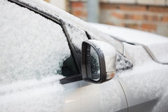 Closeup of a car covered in snow Stock Image