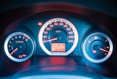 Closeup car dashboard. Modern car illuminated dashboard closeup Stock Photography