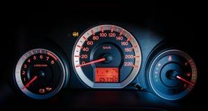 Closeup car dashboard. Modern car illuminated dashboard closeup Royalty Free Stock Photography