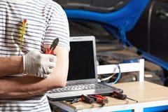 Closeup of car electrician man Stock Photography