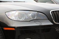 Closeup of car headlight Stock Images