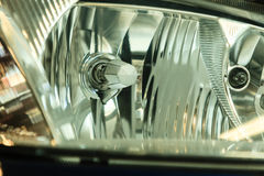 Closeup of car headlight detail Stock Photos