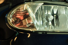 Closeup of car headlight detail Stock Photography
