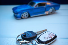 Closeup of car keys and toy car Royalty Free Stock Image