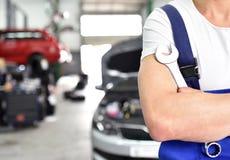 Closeup car mechanic in workshop with tool. Closeup background car lifting platform stock photo