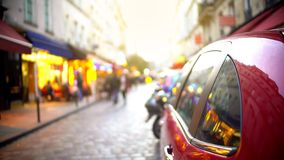 Closeup of car parked on narrow street, traffic violations, tourist route. Stock footage stock images