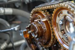 Closeup of car timing chain. Hoses and wrench stock photos