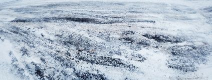 Closeup of car tire tracks in winter on the road. Covered with snow stock photo