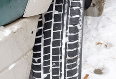 Closeup car tire tread protector full snow winter Stock Images