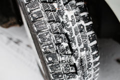Closeup of car tires in winter. the first snow in late autumn Stock Image