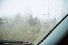 Closeup Car Wet Windshield and Windshield Wiper with Rain drop in Raining Season. Closeup Car anti-glare, rain drops on the windshield of a car Stock Image