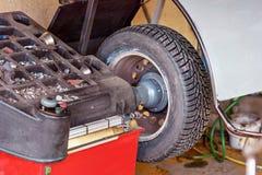 Closeup of car wheel balancing in tire service. stock photos