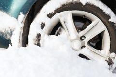 Closeup of car wheel stuck in snow Stock Photo