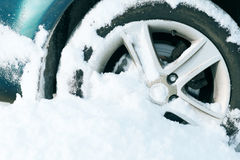 Closeup of car wheel stuck in snow Stock Photography