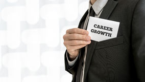 Closeup of career adviser taking his business card out of a jack. Et pocket. Conceptual of personal growth and fulfillment of ones business aims and ambitions Royalty Free Stock Photo