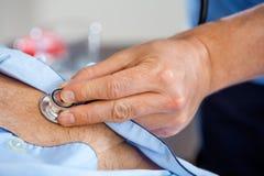 Closeup Of Caretaker Examining Senior Man's Chest Royalty Free Stock Image