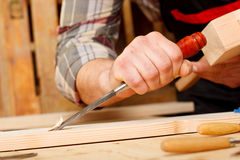 Closeup of a carpenter working with a chisel and carving tools Stock Photos