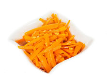 Closeup of carrot cut into julienne slices. In a beautiful white bowl against white Royalty Free Stock Photos