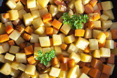 Closeup on carrot and swede dice and parsley. Closeup on orange carrot and yellow swede dice and green parsley Stock Photo