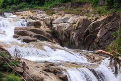 Closeup Cascade of Foamy Waterfalls along Brown Stones Royalty Free Stock Images