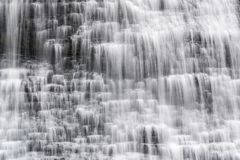 Closeup of cascading waterfall in small tiers with smooth flowin. G motion. Refreshing and relaxing outdoor scene Stock Photo