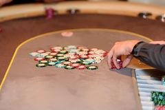 Closeup of casino dealer with chips and cards, selective focus. Closeup of casino dealer with chips and cards Royalty Free Stock Images