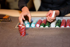 Closeup of casino dealer with chips and cards, selective focus. Closeup of casino dealer with chips and cards Royalty Free Stock Photo
