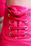 Closeup casual pink sneaker shoe boot on feet Stock Photo