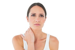 Closeup of a casual woman suffering from neck ache Stock Images