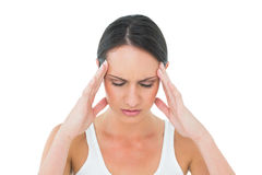 Closeup of a casual young woman suffering from headache Stock Image