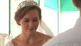 Closeup Caucasian Bride in Lacy Dress Sit in Mosque in Saigon stock video footage