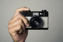 Man with a film camera in his hand Royalty Free Stock Photography