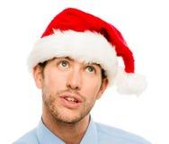 Closeup of caucasian man wearing christmas hat for santa isolate Stock Photo