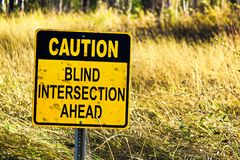 Closeup of a Caution Blind Intersection Ahead sign.  Stock Photography
