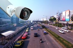 Closeup CCTV Camera of security outdoor at blurred on the traffic road stock images