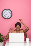 Closeup of celebrating young woman using laptop. Happy young African American woman raising hands Stock Photos