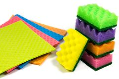 Cellulose sponge cloth and an organized stack of cleaning sponges, isolated on the white background, Closeup. Closeup of cellulose sponge cloth and an organized stock photos