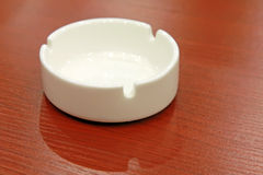 Ceramic ashtray on the red table. Closeup of ceramic ashtray on the red table Stock Photos