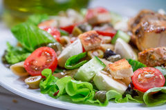 Closeup of cesar salad with vegetables. On old wooden table Stock Images