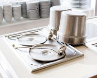Closeup of chafing dishes at a party. Closeup of chafing dishes on shelves at a party Royalty Free Stock Images