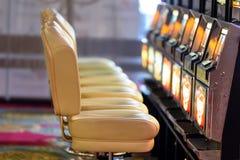 Closeup of chairs and slot mashines. Close up of chairs and slot mashines Royalty Free Stock Image