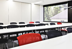 Closeup of chairs and tables in a conference room Royalty Free Stock Image