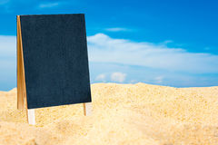 Closeup of a chalkboard on the sand of a beach. Closeup of a chalkboard on the sand Royalty Free Stock Photo