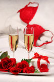 Closeup of champagne glasses and roses Stock Photo