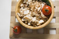 Closeup of champignons bowl with tomatoes Stock Image