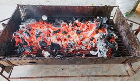 Closeup charcoal and fire ,bright flame in the fireplace royalty free stock image