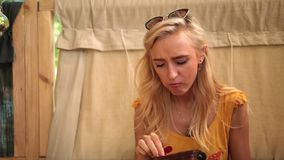 Closeup of charming blonde woman enjoying a lunch stock footage
