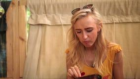 Closeup of charming blonde woman enjoying a lunch Stock Photos