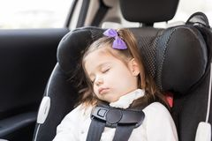 Infant Sleeping In Car. Closeup of charming female child sleeping on car seat stock images